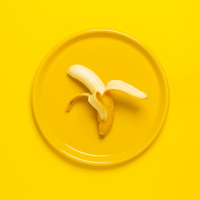 photo-of-peeled-banana-on-yellow-plate-and-background-2872767